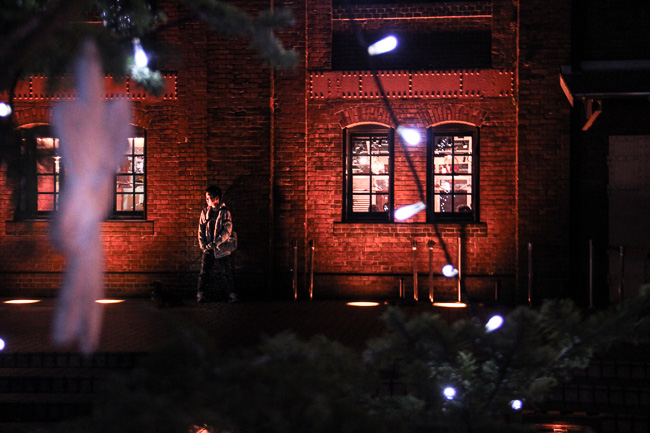 Red Brick Warehouse Christmas Market 2016-a man standing lonely-Unseen Japan